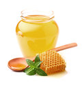 Honey with mint and wooden spoon Stock Image