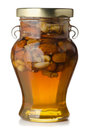 Honey and nuts jar with on white Stock Photos