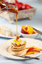 Honey on pancakes Royalty Free Stock Photos