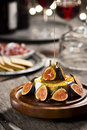 Honey Poured Over Brie Cheese and Figs at Festive Party Royalty Free Stock Photo