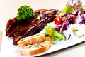 Honey roasted pork ribs. Royalty Free Stock Photo