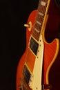 Honey sunburst vintage electric blues guitar closeup on black background. Shallow depth of field. Royalty Free Stock Photo