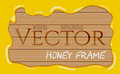 Honey syrup flowing drops frame on wooden background
