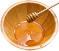 Honey on the wooden dipper Royalty Free Stock Photography