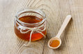 Honey in a wooden spoon and jar Royalty Free Stock Photo