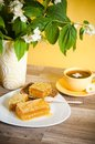 Honeycomb with a cup of tea Stock Photography