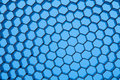 Honeycomb grid against blue background close up of texture Royalty Free Stock Images