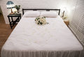 Honeymoon bed decorated white rose Royalty Free Stock Photo