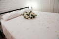 Honeymoon bed decorated white rose Stock Photos
