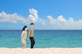Honeymoon couple on the beach beautiful Royalty Free Stock Photo