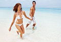Honeymoon couple couple walking on the beach Royalty Free Stock Images