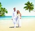 Honeymoon couple romantic walking summer beach concept Royalty Free Stock Images