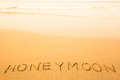 Honeymoon, text written in sand on a beach Royalty Free Stock Photo