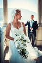 Honeymooners beautiful bride and groom on the terrace Royalty Free Stock Photography