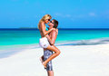 Honeymooners man carries women on the maldives beach Royalty Free Stock Photo