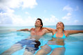 Honeymooners relaxing in swimming pool couple Royalty Free Stock Images