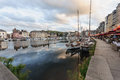 Honfleur france september scene of vieux port old harbor houses and boats in france on september is located in Stock Images