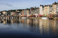 Honfleur france september scene of vieux port old harbor houses and boats in france on september is located in Stock Photo