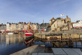 Honfleur france september scene of vieux port old harbor houses and boats in france on september is located in Royalty Free Stock Images