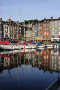 Honfleur france september scene of vieux port old harbor houses and boats in france on september is located in Stock Photos
