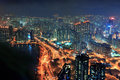 Hong kong aerial night victoria harbor view with skyline and urban skyscrapers at Royalty Free Stock Images