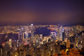 Hong kong city skyline panorama at night with victoria harbor and skyscrapers Royalty Free Stock Image