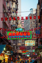 Hong kong cityscape view with plenty advertisements jan bright and billboards people walking at crowded streets Royalty Free Stock Images