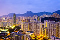 Hong kong crowded buildings under lion rock hill it is a night scene in Royalty Free Stock Photos