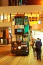 Hong kong double decker tram speeding through the wan chai district of island has the most deck trams Stock Images