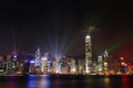 Hong kong night view skyline at with lights show and skyscrapers over sea with laser beams Stock Photography