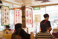 Hong Kong- October 7, 2016: Interior of a traditional Chinese canteen or cafe Royalty Free Stock Photo