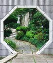 Octogonal shaped entrance to the park in Hong Kong with various greenery on background. Royalty Free Stock Photo