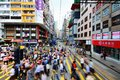 Hong kong pedestrians cross the tramway tracks october in china the line has been running for over years Royalty Free Stock Photo