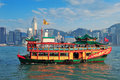 Title: Hong Kong skyline with boats
