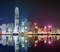 Hong kong skyline at victoria harbor with reflections Stock Images