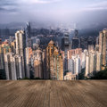 Hong kong skyscrapers cityscape of and skyline with wooden ground Royalty Free Stock Photo