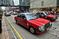 Hong kong taxi speeding passing in canton road tsim sha tsui district Royalty Free Stock Photos