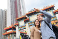 Hong kong tourist attraction wong tai sin temple tourists taking selfie photo pictures by famous landmark romantic Stock Photography