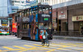 Hong kong tramway a bicyclist riding along the on central district island Royalty Free Stock Photo