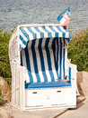 Hooded beach chair typical at the northsea Stock Images