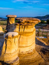 Hoodoos drumheller bathed in the warm light of a summer sunset at alberta canada Royalty Free Stock Photo