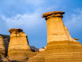 Hoodoos drumheller bathed in the warm light of a summer sunset at alberta canada Stock Photos