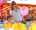 Hook the duck fun fair photo of young girl having trying to at whitstable in kent on th may photo ideal for fairs leisure Royalty Free Stock Photography