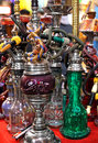 Hookah assortment of traditional water pipes on market Royalty Free Stock Photos
