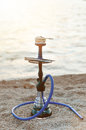 Hookah and tobacoo on a beach Royalty Free Stock Photo