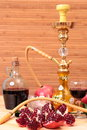 Hookah wine and sweets still life with garnet Stock Image