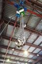 Hooks of weigher bridge crane in warehouse Royalty Free Stock Photo