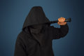 Hooligan with baseball bat man in hood and mask holds Royalty Free Stock Photography
