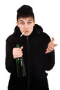 Hooligan with a beer and cigarette isolated on the white background Royalty Free Stock Image