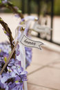 Hooray sign on a wedding basket with purple flowers Stock Photography